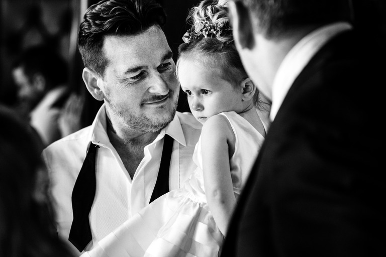 groom holding his daughter