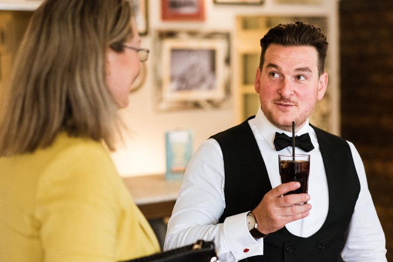 groom enjoying a pre-wedding drink