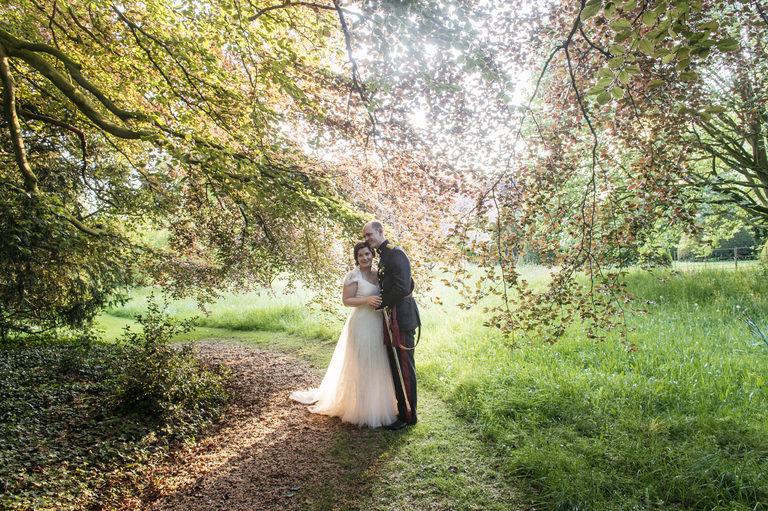couples portrait under a sunlit tree