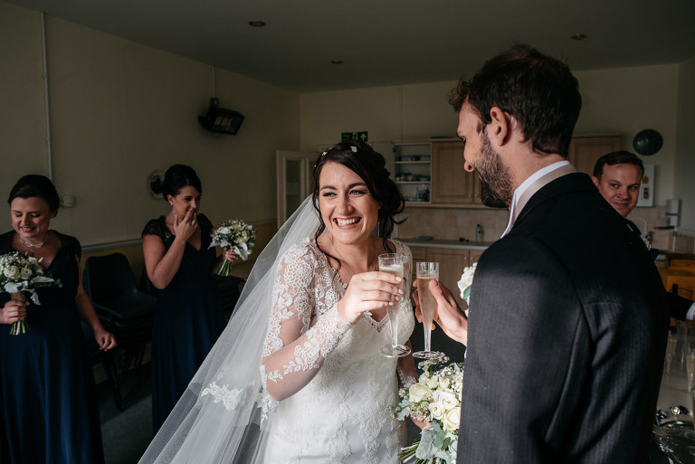 bride and groom toast with champagne