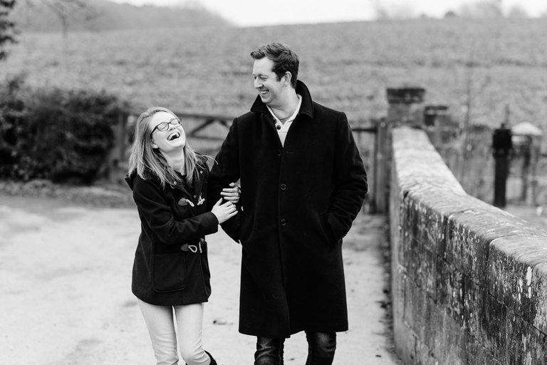 Young engaged couple laughing together