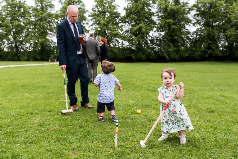 kids playing croquet at wedding